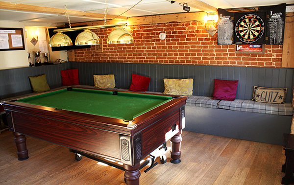 Pool table and dart board.